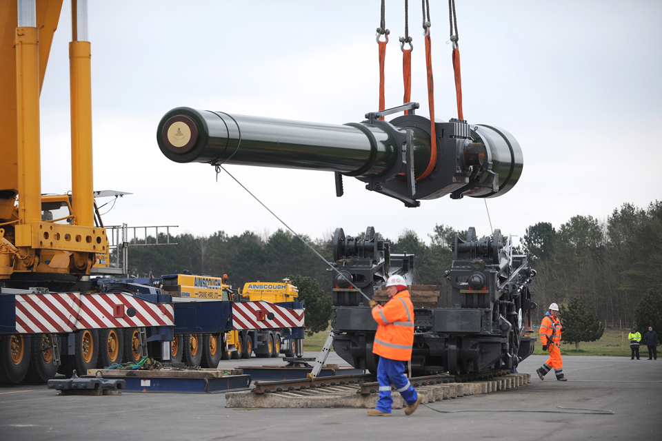 Logisticians lift the howitzer's barrel out of its carriage