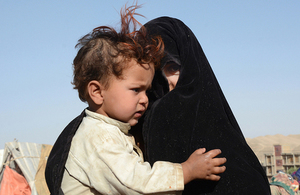 An Afghan woman and child displaced by drought. Picture: OCHA/Philippe Kropf