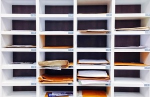 Mail separated in post compartments via Thana Thanadechakul at Shutterstock