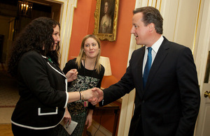 Prime Minister shaking hands with a community worker