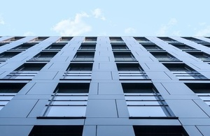 A cladding covered high rise building shot from below