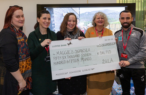Representatives from Maggie's Swansea including Leon Britton of Swansea City Football Club accept the cheque from DVLA Chief Executive Julie Lennard