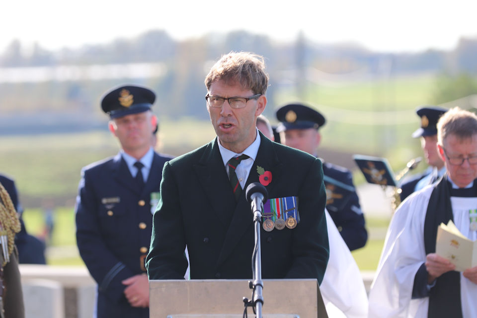 Defence Minister Tobias Ellwood delivers a reading during a service, Crown Copyright, All rights