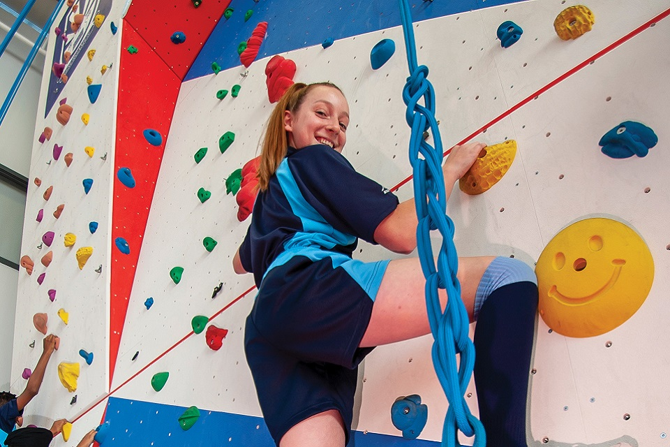 Secondary school girl on climbing wall