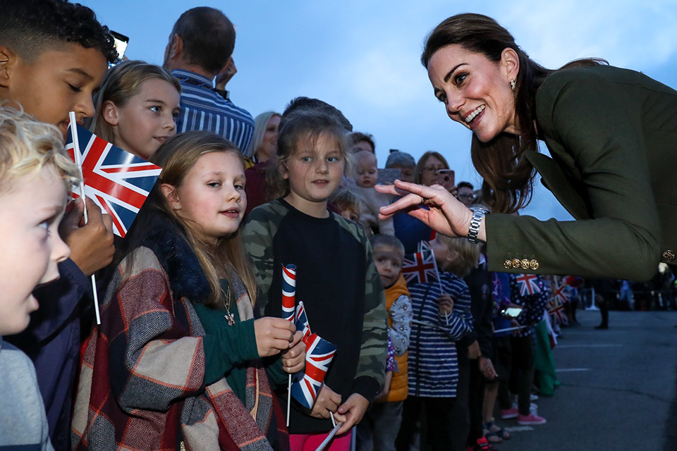 Her Royal Highness the Duchess of Cambridge meets with a group of children as part of the visit.