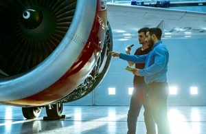 Maintenance engineers diagnose a jet engine via Gorodenkoff at Shutterstock