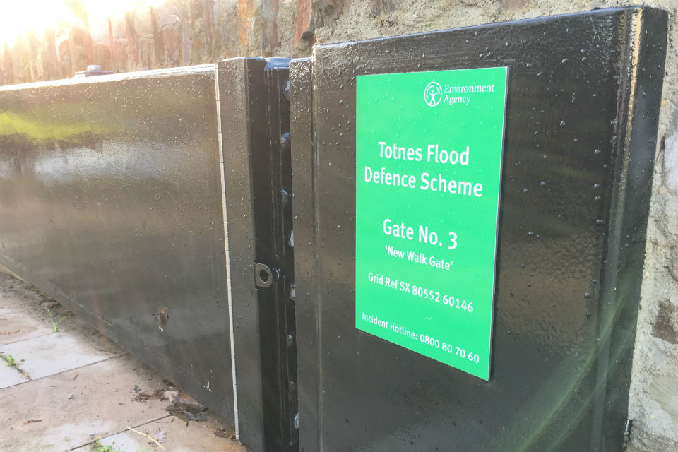 One of the black, metal flood gates swung open