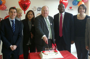 Eric Pickles cuts an 'I love Tottenham' cake
