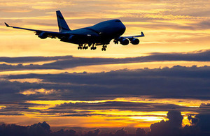 Picture of a commercial passenger plane at sunset.