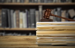A gavel on top of a pile of documents.