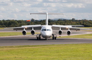 Front view of Avro RJ85 aircraft on the runway