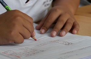 Child writing in workbook