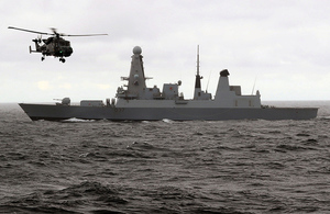 HMS Duncan with Wildcat helicopter. Crown copyright.
