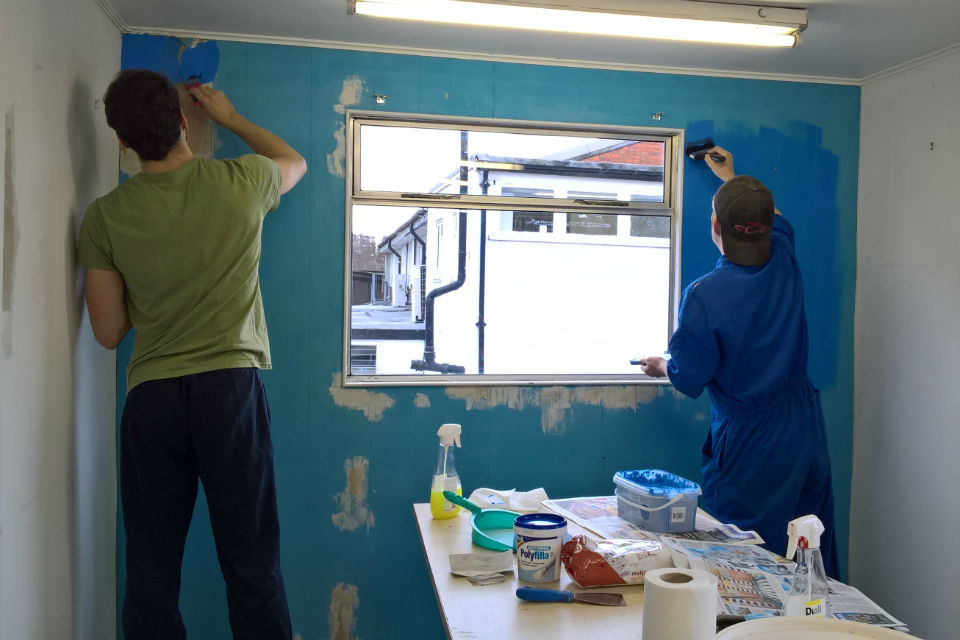 Highways England staff painting the art room