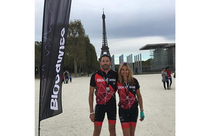 Martin O' Brian and Rebecca Phillips celebrate outside the Eiffel Tower, after completing their London to Paris cycle challenge for Bloodwise.