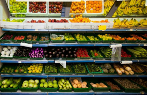 supermarket shelves filled with fruit