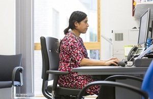 Side view of a doctor working at her desk.