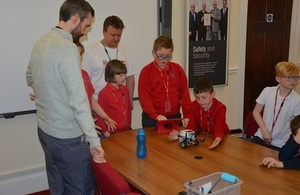 Youngsters work on their presentation as LLWR staff look on.