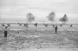 Troops land on a beach at Normandy, 75 years ago