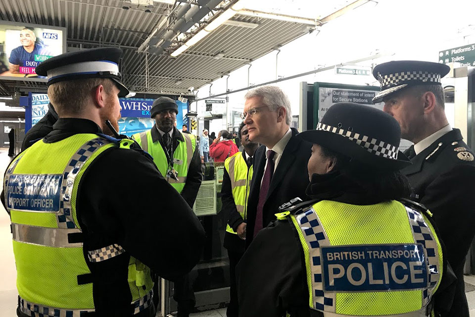 Minister Andrew Jones with British Transport police members.