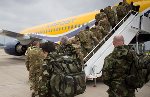 A joint Irish Defence Force and British Army training and mentoring team boards an aircraft at RAF Brize Norton headed for Mali [Picture: Steve Lympany, Crown copyright 2013]