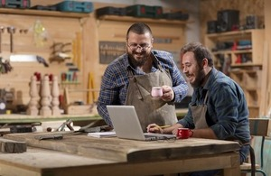 Two woodwork designers in their workshop via Fh Photo at Shutterstock