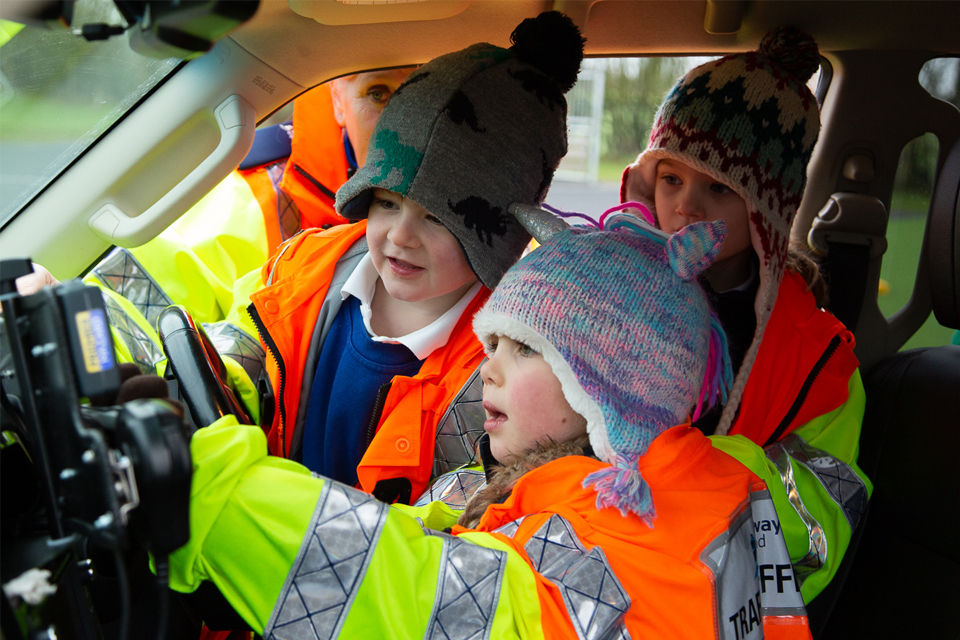 Children in a Traffic Officer vehicle