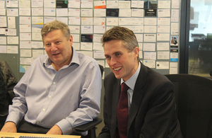 The Secretary of State and General Sir Chris Deverell are briefed on the projects being carried out by jHub