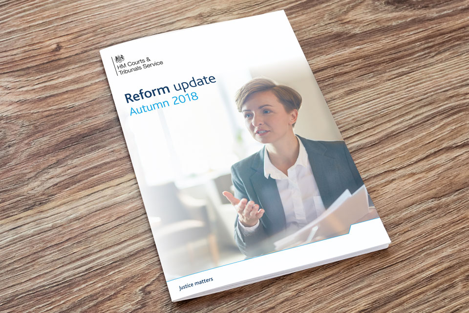Image of cover of reform update document on a table.