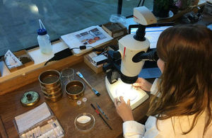MOLA Headlandarchaebotanist Lara Gonzalez views the sample through a microscope