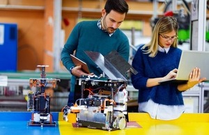 Colleagues work on a mechatronics project together via ndr3000 at Shutterstock