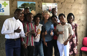 Minister Baldwin meets young people during her visit to Mozambique.
