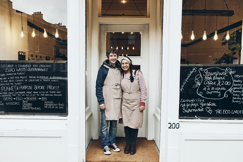 Matthew and Stephanie, directors of the Eco Larder, standing together outside their shop.