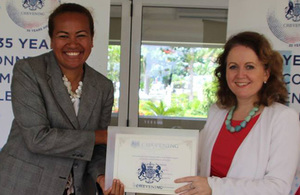 Dr Lusiana Manoa receives her certificate from High Commissioner Melanie Hopkins