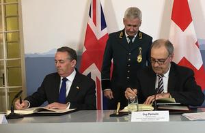 International Trade Secretary, Dr Liam Fox, signs trade agreement alongside Swiss Federal Councillor, Guy Parmelin