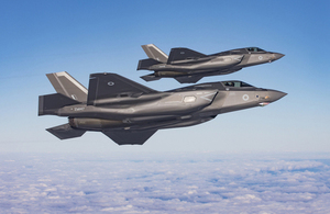 Two RAF F-35B Lightning break away together over the North Sea.