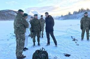 Defence Secretary Gavin Williamson speaks to Royal Marines and Norwegian personnel on winter training in Norway.