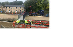 Construction workers replace footbridge at Cragg Brook