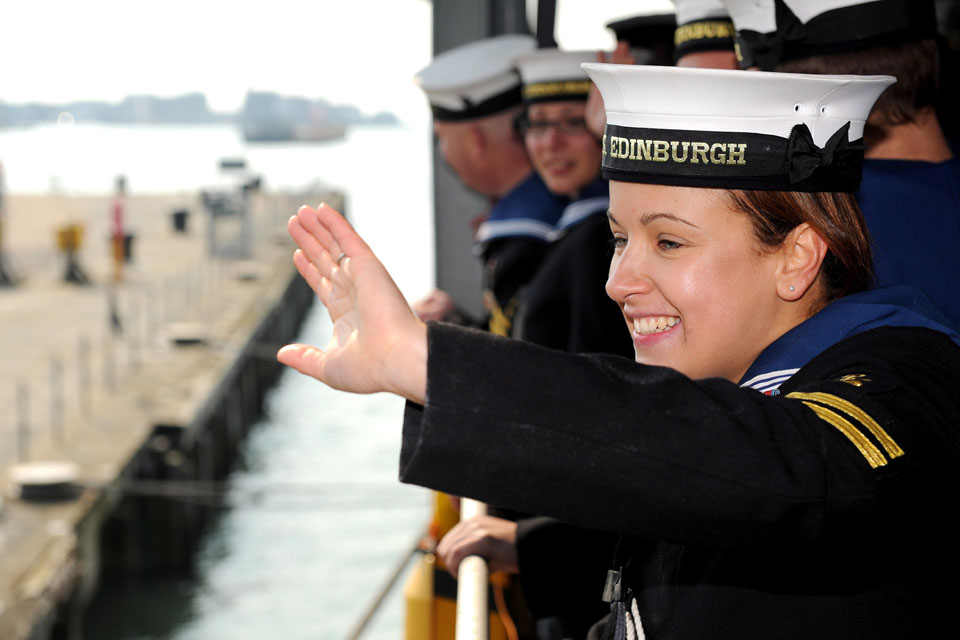 Leading Logistician Gemma Raybould waves to loved ones ashore