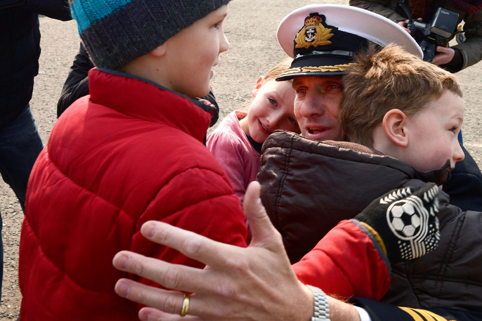Commander Nick Borbone is greeted by his children