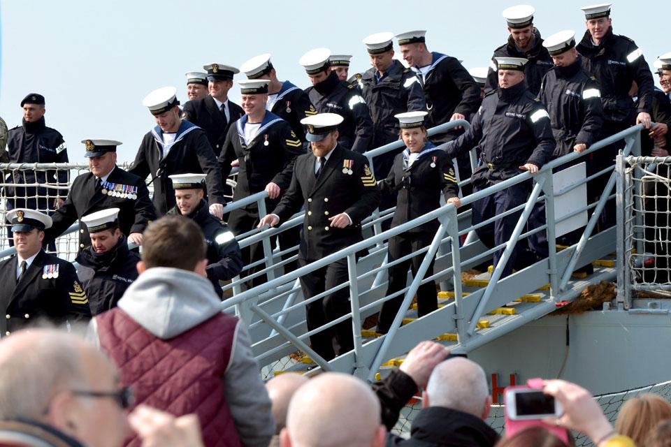 Members of HMS Edinburgh's ship's company descend the gangway