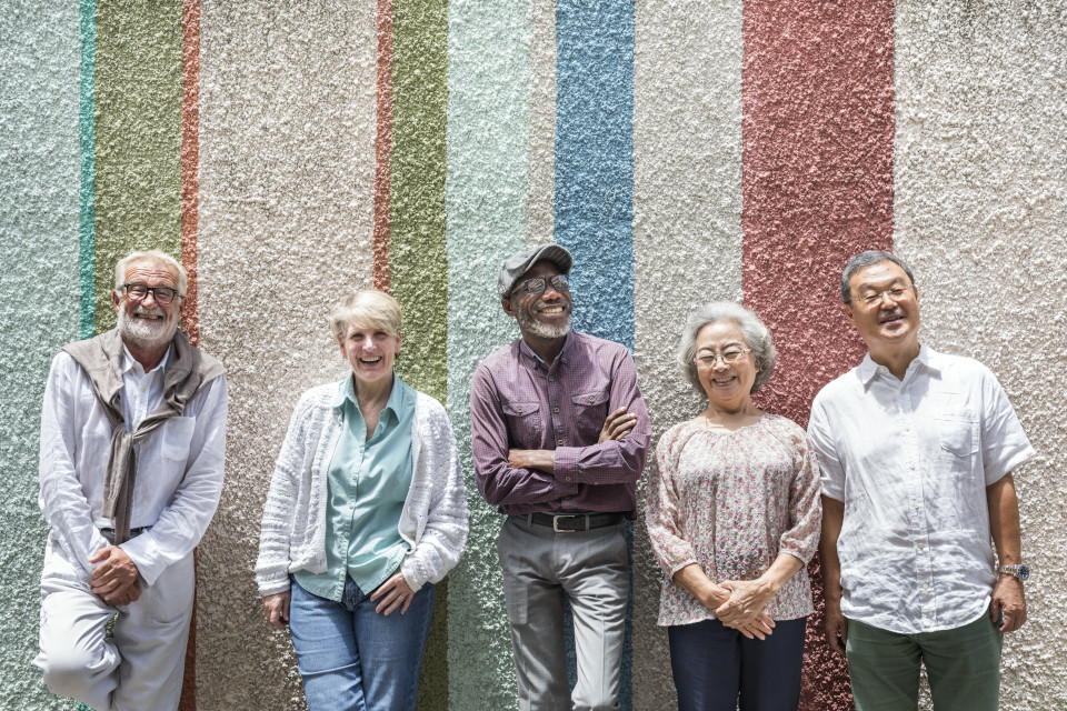 Diverse group of 5 older men and women smiling