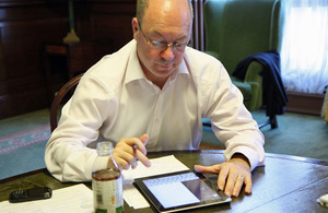 Alistair Burt answering questions on twitter.