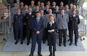Defence Secretary Gavin Williamson and his German counterpart Ursula Von Der Leyen standing with visiting officers from both the UK and German Armed Forces on the ramp of a A400M training aircraft at 24 Sqn RAF Brize Norton.