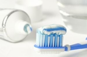 Toothbrush with fluoride toothpaste