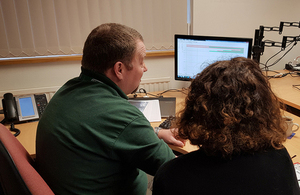 Image of RAIB staff reviewing information on a computer screen