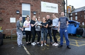 LLWR apprentices outside Calderwood House with Hostel Manager Steve Pettit,