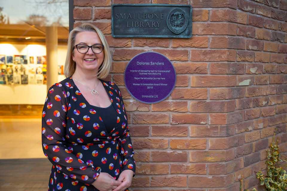 Dolores Sanders, Strategic Director of Total Control Pro Ltd, with her commemorative purple plaque.