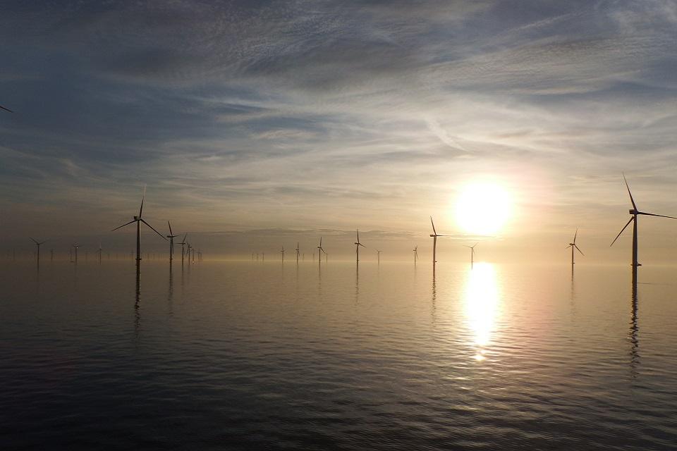 View of wind turbines at sea at sunset. (Copyright: Gwynt Y Mor wind farm, Rory McKerrell, RWE Innogy)