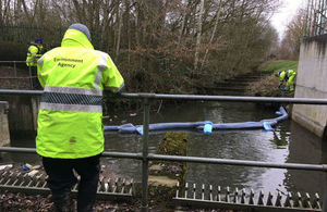 Environment Agency Officers have installed booms to contain the oil